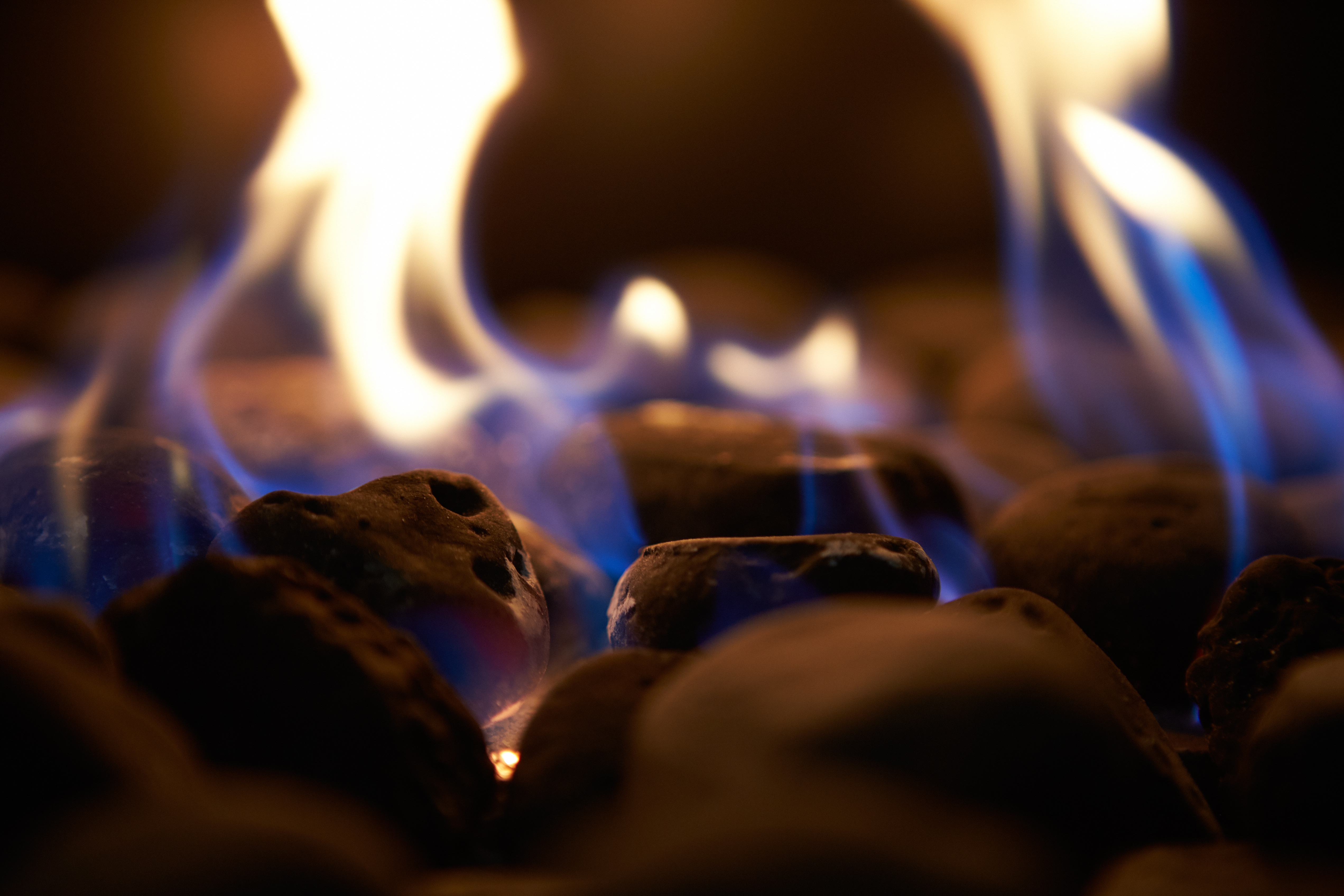 Close Up Of Flaming Coals On Gas Fire